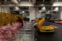 A robot drops a parcel in a mail sack at the Hellenic Post's sorting centre in Kryoneri