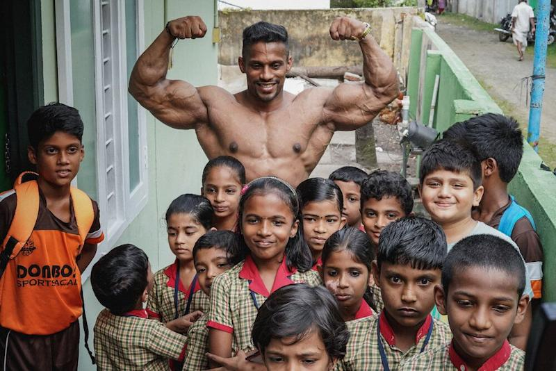 Chitharesh poses for a photo with children from a local school who came to meet 'the man who has put Kerala on the map'. (Photo: Manu Paul)
