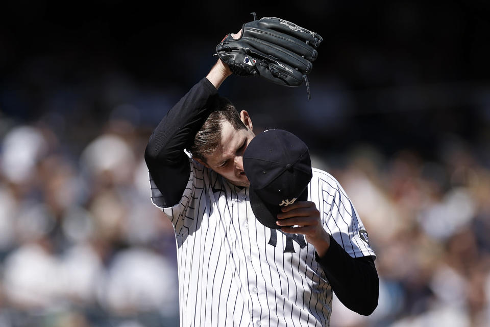 New York Yankees pitcher Jordan Montgomery reacts during the third inning of a baseball game against the Tampa Bay Rays on Saturday, Oct. 2, 2021, in New York. (AP Photo/Adam Hunger)