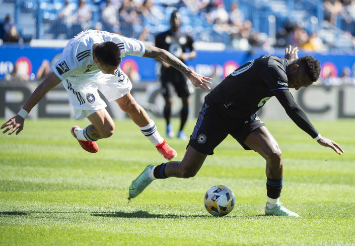 CF Montreal's Romell Quioto, right, challenges Chicago Fire FC's Federico Navarro during first half MLS soccer action in Montreal, Sunday, Sept. 19, 2021. (Graham Hughes/The Canadian Press via AP)