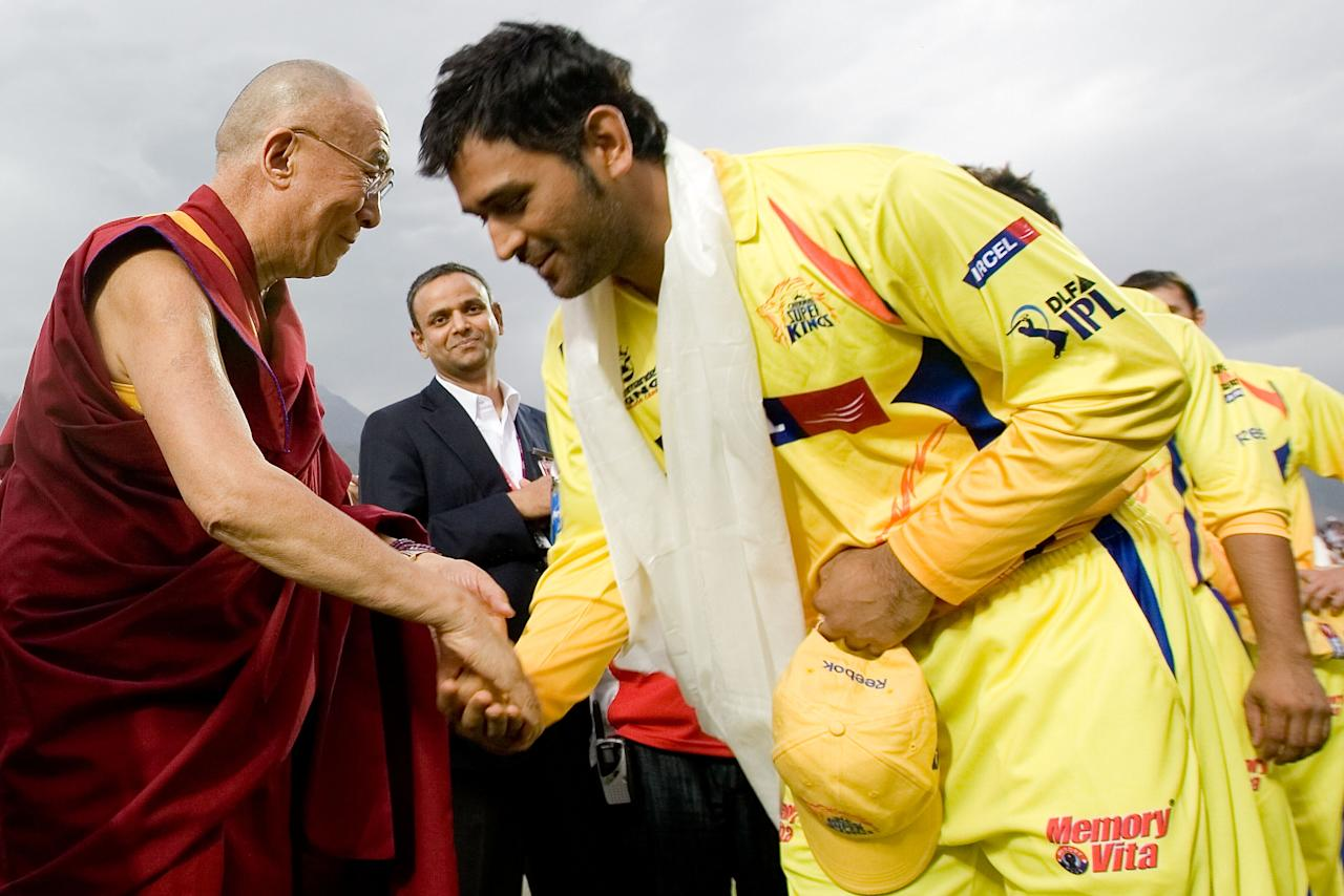 DHARAMSALA, INDIA - APRIL 18: (R-L)Mahendra Singh Dhoni and His Holiness The Dalai Lama during the 2010 DLF Indian Premier League T20 group stage match between Kings XI Punjab and Chennai Super Kings played at Himachal Pradesh Cricket Association Stadium on April 18, 2010 in Dharamsala, India.  (Photo by Ritam Banerjee-IPL 2010/IPL via Getty Images)