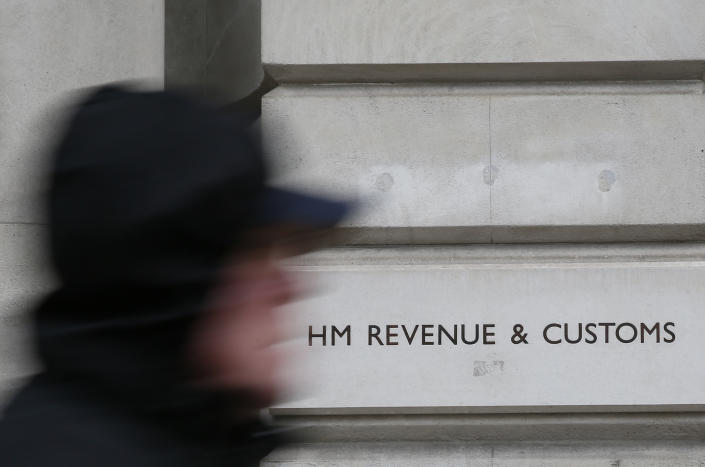 A pedestrian walks past the headquarters of Her Majesty's Revenue and Customs (HMRC) in central London February 13, 2015. British lawmakers plan to call up the bosses of HSBC and the tax authority, HMRC, to quiz them over allegations some clients of HSBC's Swiss private bank evaded tax.     REUTERS/Stefan Wermuth (BRITAIN - Tags: BUSINESS POLITICS CRIME LAW)