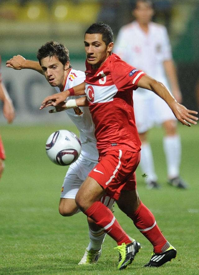 Pablo Sarabia Garcia (L) of Spain vies for the ball with Muhammet Demir (R) of Turkey during football final tournament of UEFA European Under-19 Championship 2010/2011 in Chiajna village next to Bucharest July 26, 2011. Turkey won 3-0. AFP PHOTO/DANIEL MIHAILESCU (Photo credit should read DANIEL MIHAILESCU/AFP/Getty Images)
