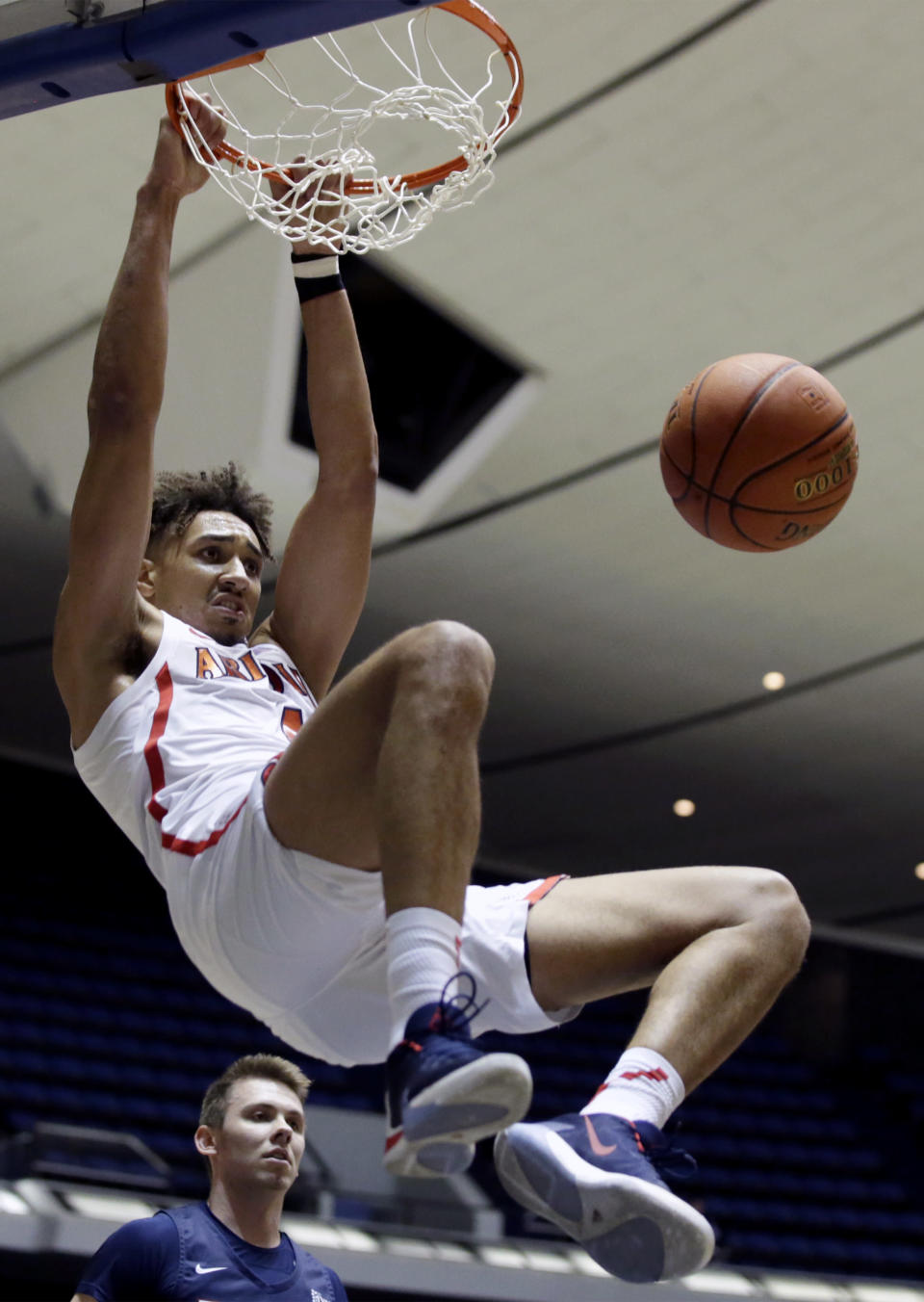 Arizona center Chase Jeter dunks in front of Pennsylvania guard Ryan Betley during the first half of an NCAA college basketball game at the Wooden Legacy tournament in Anaheim, Calif., Friday, Nov. 29, 2019. (AP Photo/Alex Gallardo)