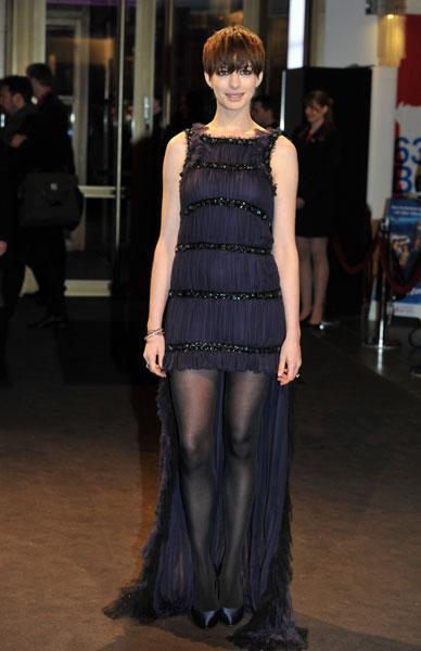 <b>Anne Hathaway at the Les Miserables premiere in Berlin, Feb 2013 </b><br><br>The actress dazzled in a Chanel Haute Couture navy gown with fringe detail, teamed with black tights and stilettos.<br><br>Image © Rex