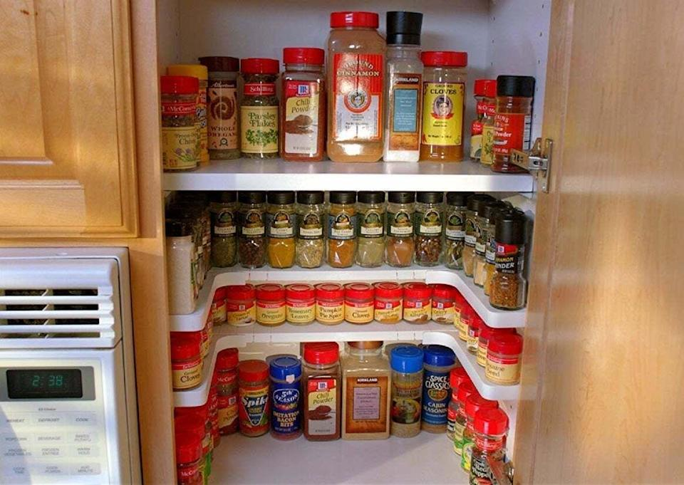 """Add this to your cabinet, andyou'll actually be able to see the massive collection of seasonings you've somehow accumulated over the years.<br /><br /><strong>Promising review:</strong>""""With all our spices on one level, we had to take out every spice to get to the ones in the back. Now they are all visible and you can just reach in and take out the one you need. Easy peasy!"""" —<a href=""""https://www.amazon.com/dp/B077VTX4KZ?tag=huffpost-bfsyndication-20&ascsubtag=5833640%2C4%2C43%2Cd%2C0%2C0%2C0%2C962%3A1%3B901%3A2%3B900%3A2%3B974%3A3%3B975%3A2%3B982%3A2%2C16261685%2C0"""" target=""""_blank"""" rel=""""noopener noreferrer"""">Kindle Customer<br /></a><br /><strong>Get a set of two from Amazon for<a href=""""https://www.amazon.com/dp/B077VTX4KZ?tag=huffpost-bfsyndication-20&ascsubtag=5833640%2C4%2C43%2Cd%2C0%2C0%2C0%2C962%3A1%3B901%3A2%3B900%3A2%3B974%3A3%3B975%3A2%3B982%3A2%2C16261685%2C0"""" target=""""_blank"""" rel=""""noopener noreferrer"""">$27.99</a>.</strong>"""