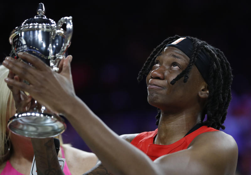 Indiana Fever's Erica Wheeler, of Team Wilson, cries as she holds up the MVP trophy after winning the honor at the WNBA All-Star basketball game Saturday, July 27, 2019, in Las Vegas. (AP Photo/John Locher)