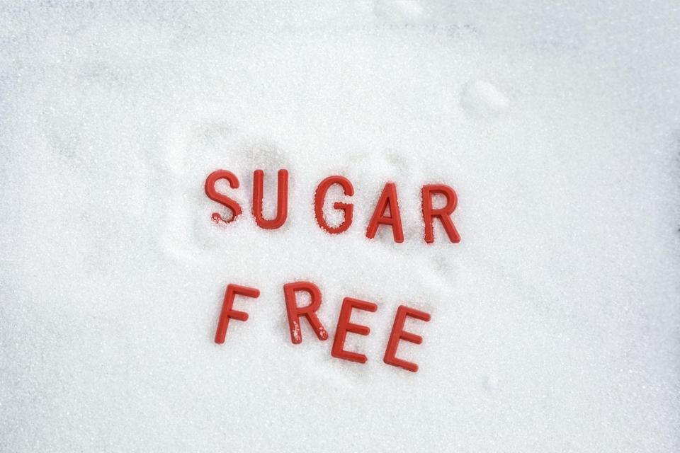 """<p>The term """"sugar free"""" will lead you to believe that there is zero sugar in whatever you're about to buy or ingest. But according to the FDA guidelines, <a href=""""https://www.ncbi.nlm.nih.gov/books/NBK209851/#:~:text=Sugars,sugars%20except%20as%20noted%20below."""" rel=""""nofollow noopener"""" target=""""_blank"""" data-ylk=""""slk:&quot;sugar free&quot; means a food must contain less than 0.5 grams of sugar"""" class=""""link rapid-noclick-resp"""">""""sugar free"""" means a food must contain less than 0.5 grams of sugar</a>. Not only does this mean a small amount of sugar can still be in the product, but it also doesn't cover certain sweeteners, like agave, brown rice syrup, or sugar alcohols. </p>"""