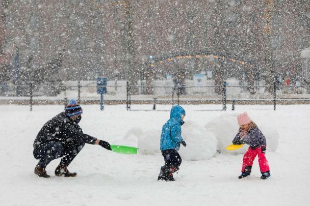 PHOTO: People play in the Stuy Town housing complex as snow falls in New York City, Feb. 7, 2021. (Andrew Kelly/Reuters)