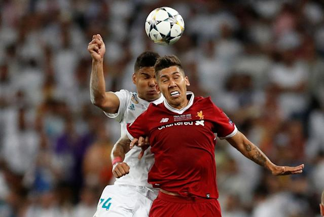 Soccer Football - Champions League Final - Real Madrid v Liverpool - NSC Olympic Stadium, Kiev, Ukraine - May 26, 2018 Real Madrid's Casemiro clashes with Liverpool's Roberto Firmino REUTERS/Andrew Boyers