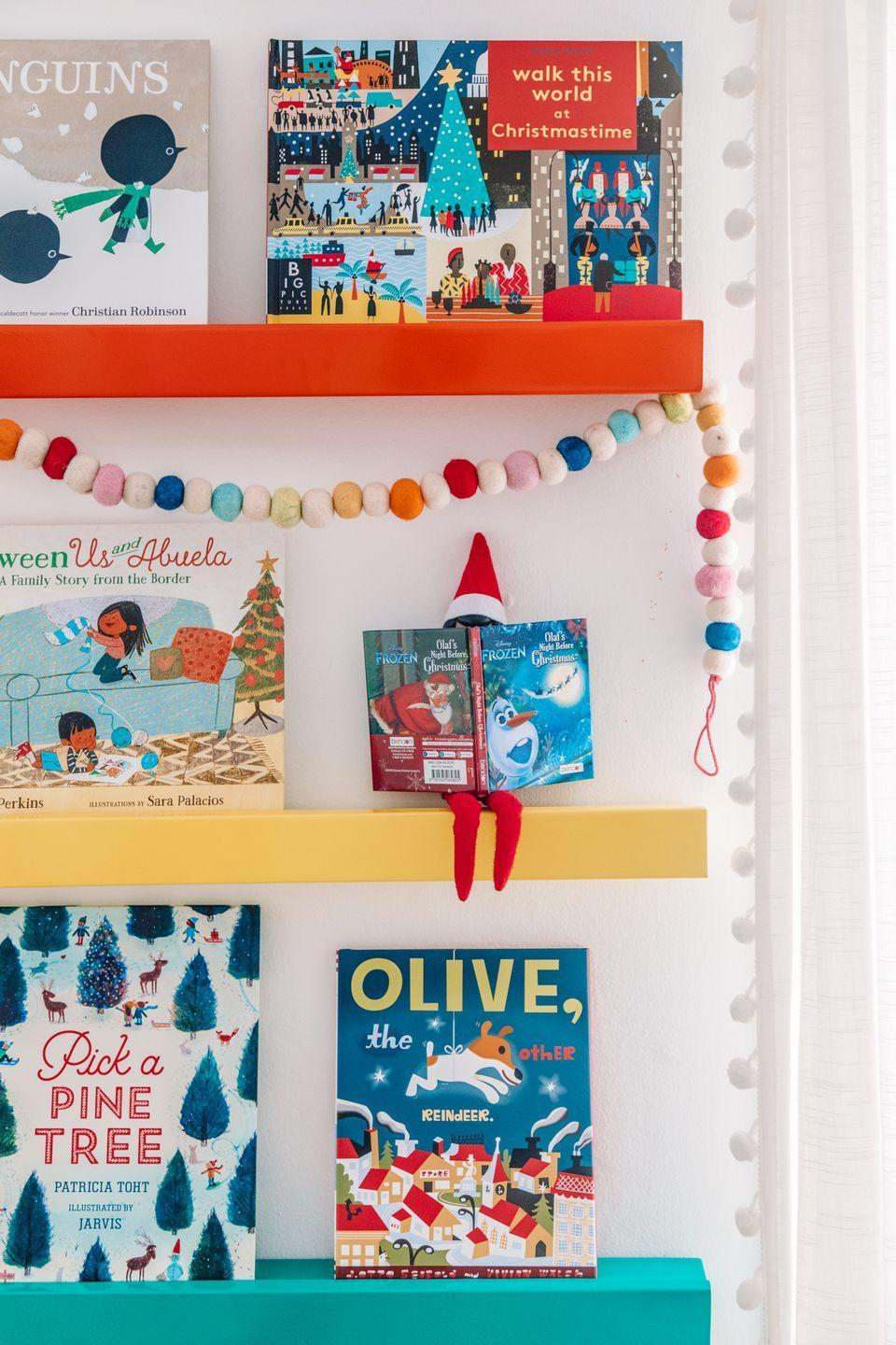 """<p>It's called """"Elf on the Shelf"""" for a reason, you know! Here, your Elf takes a seat behind a children's book and settles in for a good old-fashioned reading session.</p><p><strong>Get the tutorial at <a href=""""https://studiodiy.com/our-2019-holiday-home-tour/"""" rel=""""nofollow noopener"""" target=""""_blank"""" data-ylk=""""slk:Studio DIY"""" class=""""link rapid-noclick-resp"""">Studio DIY</a>.</strong></p><p><strong><a class=""""link rapid-noclick-resp"""" href=""""https://go.redirectingat.com?id=74968X1596630&url=https%3A%2F%2Fwww.walmart.com%2Fip%2FLittle-Ree-Little-Ree-Hardcover-9780062453181%2F55134289&sref=https%3A%2F%2Fwww.thepioneerwoman.com%2Fholidays-celebrations%2Fg34080491%2Ffunny-elf-on-the-shelf-ideas%2F"""" rel=""""nofollow noopener"""" target=""""_blank"""" data-ylk=""""slk:SHOP LITTLE REE BOOKS"""">SHOP LITTLE REE BOOKS</a><br></strong></p>"""