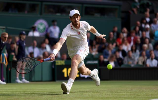Andy Murray chases a forehand on Centre Court