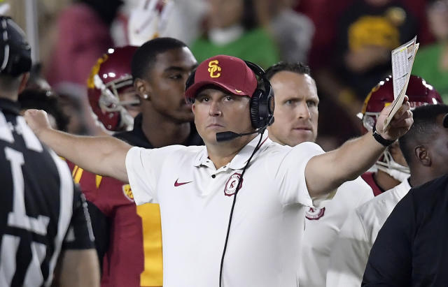 FILE - In this Nov. 24, 2018, file photo, Southern California head coach Clay Helton gestures during the first half of an NCAA college football game against Notre Dame, in Los Angeles. Southern Californias bid to secure coach Clay Heltons future begins with a revamped offense, a refurbished classic stadium and a daunting opponent. When USC returns from its first losing season since 2000 to face Mountain West champion Fresno State on Saturday night, the Trojans know theyll need a quick turnaround to placate the hungry critics of Helton, who recruited these players and fostered a family culture at the West Coasts glamour program. (AP Photo/Mark J. Terrill, File)