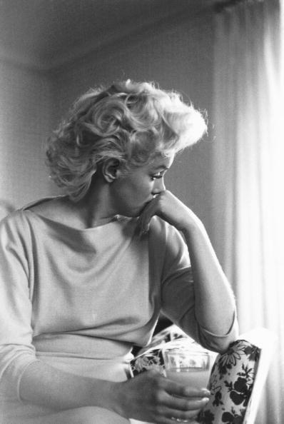<p>Marilyn appeared introspective in this candid shot in her New York hotel room. </p>