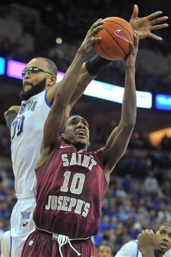 Saint Joseph's Langston Galloway (10) tries to get a shot past Creighton's Gregory Echenique (00) during an NCAA college basketball game on Saturday, Dec. 1, 2012, in Omaha, Neb. (AP Photo/Dave Weaver)