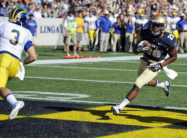 Navy running back Geoffrey Whiteside (29) scores a touchdown against Delaware defensive back Craig Brodsky (3) during the first half of an NCAA college football game, Saturday, Sept. 14, 2013, in Annapolis, Md. (AP Photo/Nick Wass)