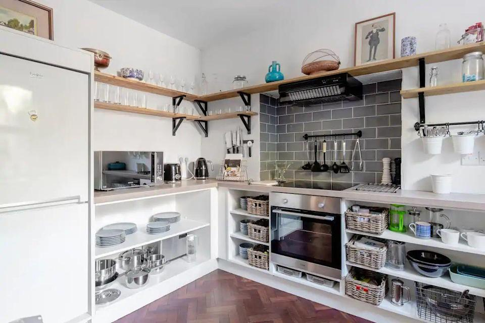 """<p>A light and airy apartment close to Galway's best restaurants and bars, this beautiful Airbnb features a gorgeous kitchen to cook up a storm during your stay, too. There are high-thread-count sheets, parquet floors and decorative fireplaces to make your break comfortable, plus vintage furniture and mementos of Irish history for added character.</p><p><strong>Sleeps:</strong> 5</p><p><a class=""""link rapid-noclick-resp"""" href=""""https://airbnb.pvxt.net/5b7Wnj"""" rel=""""nofollow noopener"""" target=""""_blank"""" data-ylk=""""slk:SEE INSIDE"""">SEE INSIDE</a></p>"""