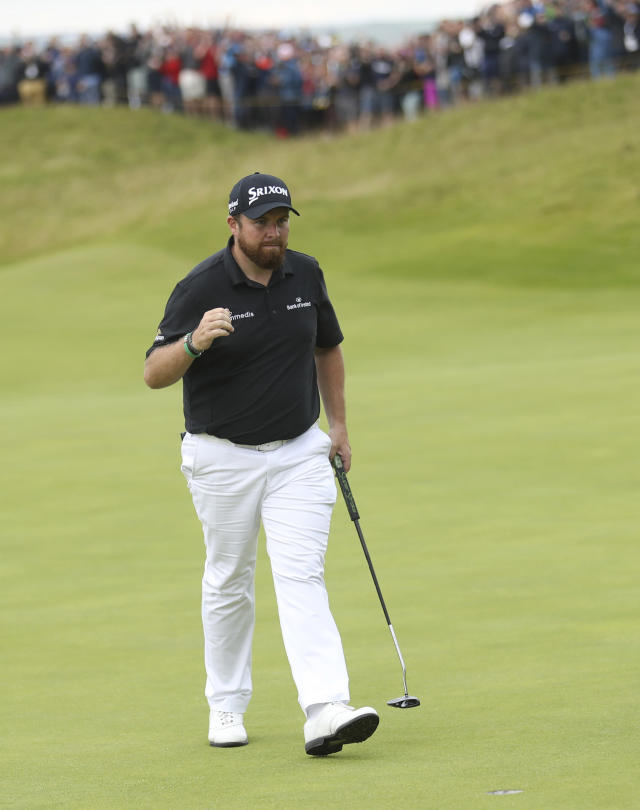Ireland's Shane Lowry acknowledges the crowd after getting a birdie on the 16th green during the third round of the British Open Golf Championships at Royal Portrush in Northern Ireland, Saturday, July 20, 2019.(AP Photo/Peter Morrison)