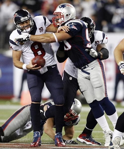 Houston Texans quarterback Matt Schaub (8) is sacked by New England Patriots defensive end Rob Ninkovich (50) during the first quarter of an NFL football game in Foxborough, Mass., Monday, Dec. 10, 2012. (AP Photo/Stephan Savoia)