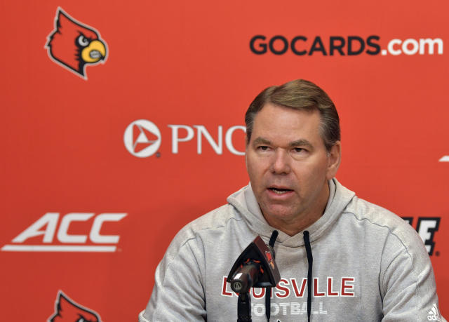 Louisville athletic director Vince Tyra speaks to the media during a press conference. (AP)