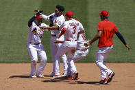 St. Louis Cardinals' Yadier Molina, left, is congratulated by teammates after hitting a walk-off RBI single during the ninth inning of a baseball game against the Miami Marlins Wednesday, June 16, 2021, in St. Louis. (AP Photo/Scott Kane)