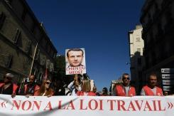France's Macron enacts his contested labour reforms