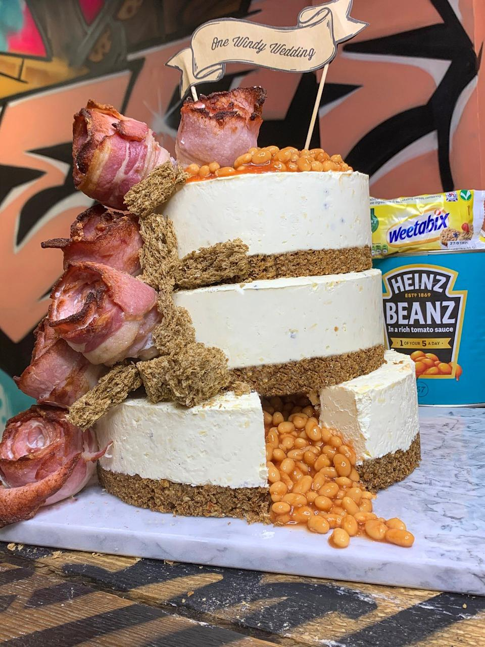 A cake, which features bacon flowers with UK Weetabix and Heinz Beanz, is going viral for all the wrong reasons. Photo: Twitter/Pleesecakes
