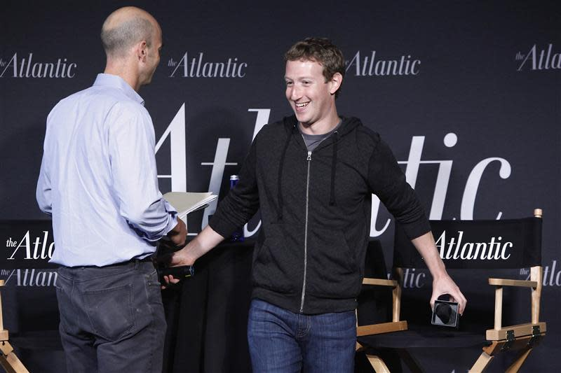 Zuckerberg takes his seat for an onstage interview for with Bennet of the Atlantic Magazine in Washington