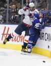Washington Capitals left wing Alex Ovechkin (8) checks Toronto Maple Leafs defenseman Cody Ceci (83) into the boards during the third period of an NHL hockey game Tuesday, Oct. 29, 2019, in Toronto. (Hans Deryk/The Canadian Press via AP)