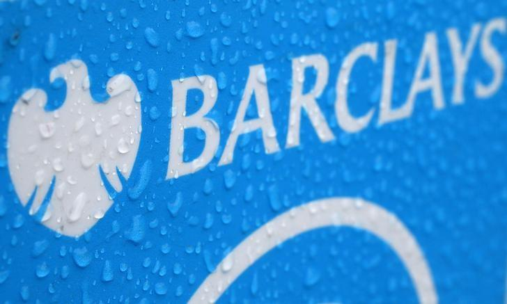 Raindrops are seen on the logo of a rental bicycle sponsored by Barclays in London
