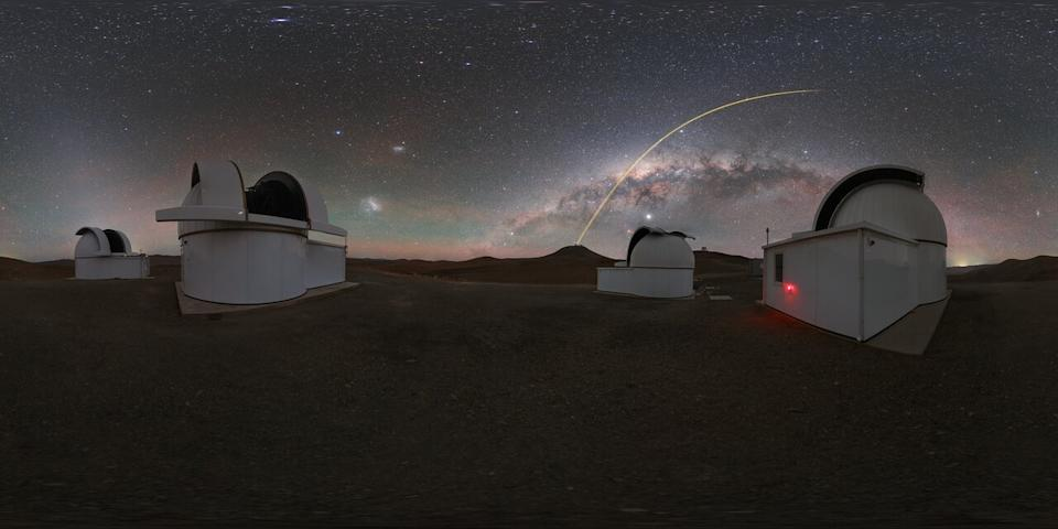 The European Southern Observatory's Very Large Telescope (VLT) beams its laser guide star into the night sky over Chile, creating a beam of light that arcs above the Milky Way galaxy. Astronomers use giant laser beams like these to help their telescopes correct for the distortion caused by turbulence in Earth's atmosphere, which can make stars appear to twinkle. For observations at the VLT, astronomers rely on the Laser Guide Star Facility at the Paranal Observatory in Chile. Pictured in the foreground are three domes of the SPECULOOS Southern Observatory.