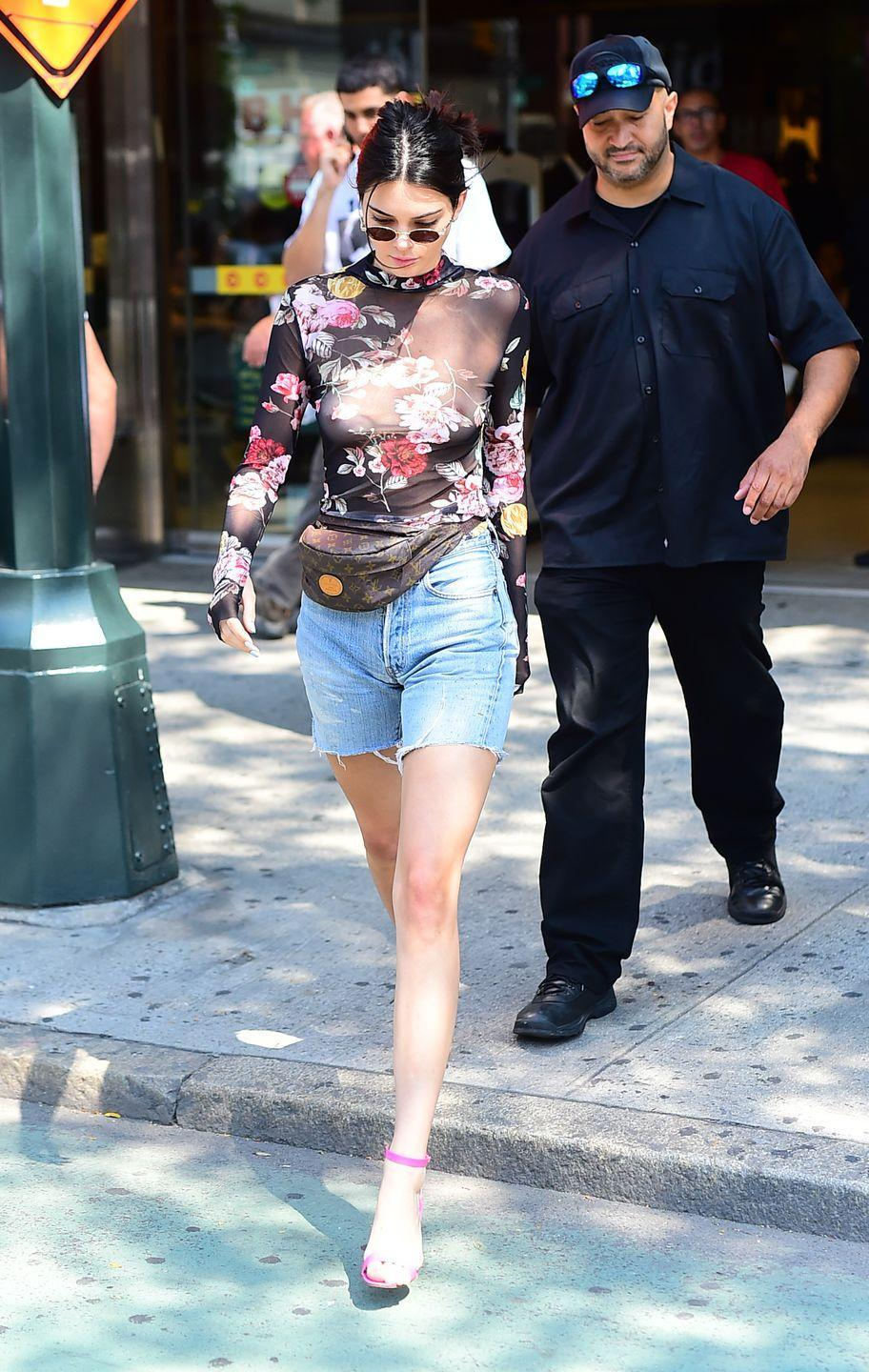 <p>Kendall Jenner pairs her nip slip with a pair of pink heels and a floral chiffon top. A great way to add some spring vibes. </p>