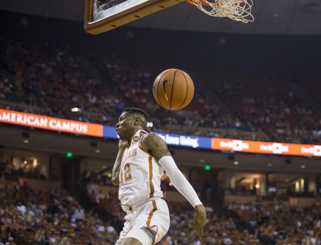 Texas guard Kerwin Roach II (12) dunks the ball during an NCAA college basketball game against Oklahoma State in Austin, Texas, on Saturday, Feb. 24, 2018. (Nick Wagner /Austin American-Statesman via AP)