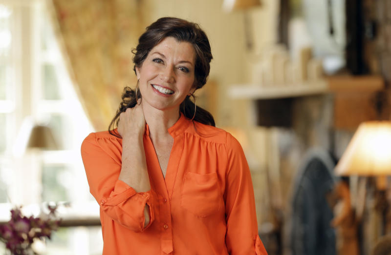 FILE - In this April 25, 2016 file photo, singer Amy Grant poses for a portrait at her home in Nashville. Grant and Nashville philanthropist Martha R. Ingram will be honored with stars on the Music City Walk of Fame next month in Tennessee. The Nashville Convention & Visitors Corp. made the announcement Thursday, March 30, 2017.   (AP Photo/Mark Humphrey)