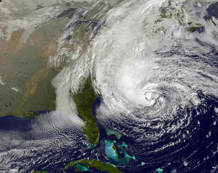 This NOAA satellite image taken Sunday, Oct. 28, 2012 shows Hurricane Sandy off the Mid Atlantic coastline moving toward the north with maximum sustained winds of 75 mph. Tens of thousands of people were ordered to evacuate coastal areas Sunday as big cities and small towns across the U.S. Northeast braced for the onslaught of a superstorm threatening some 60 million people along the most heavily populated corridor in the nation. (AP Photo/Weather Underground)