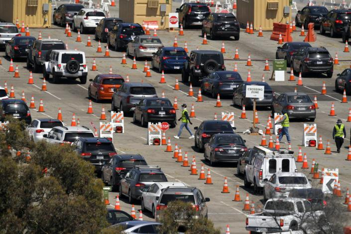 coronavirus testing site in Los Angeles with cars.