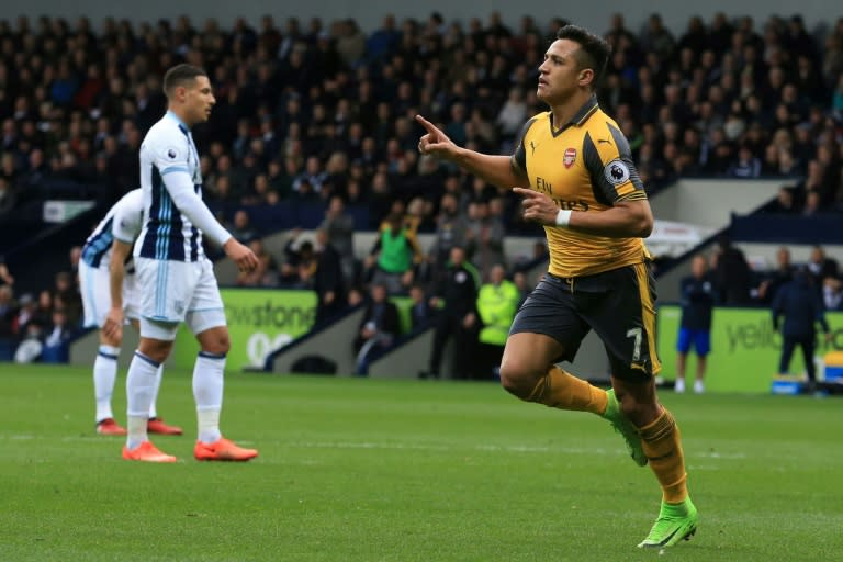 Arsenal's Alexis Sanchez (R) celebrates after scoring a goal during their English Premier League match against West Bromwich Albion, at The Hawthorns stadium in West Bromwich, on March 18, 2017