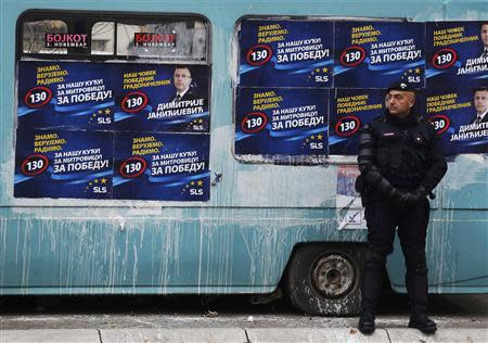 A European Union policeman secures an area near a polling station in the northern part of the ethnically-divided town of Mitrovica November 17, 2013. REUTERS/Bojan Slavkovic