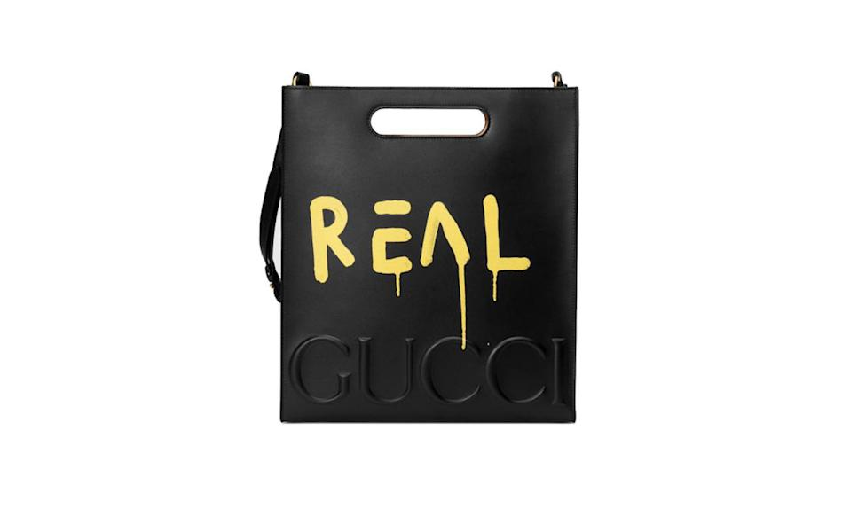 "<p>What could possibly rival last season's Dionysus supreme bag from our favorite mega-brand, Gucci? Meet this graffiti tote, which helpfully informs you it's the real thing, not a knock-off.</p><p>Gucci Ghost leather tote, $2850, <a href=""https://www.gucci.com/us/en/pr/men/mens-bags/mens-totes/guccighost-leather-tote-p-414476CVLPT8603?position=1&listName=ProductGridComponent&categoryPath=Women/Womens-Accessories/Womens-Luggage-Lifestyle-Bags"" rel=""nofollow noopener"" target=""_blank"" data-ylk=""slk:Gucci.com"" class=""link rapid-noclick-resp"">Gucci.com</a></p>"
