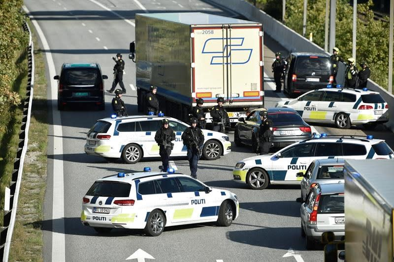 Road, rail and ferry links to Danish province sealed in crime manhunt