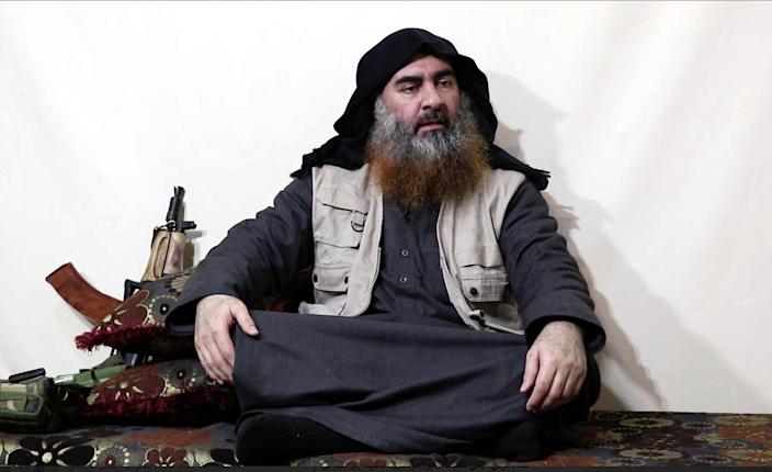 This file image made from video posted on a militant website April 29, 2019, purports to show the leader of the Islamic State group, Abu Bakr al-Baghdadi being interviewed by his group's Al-Furqan media outlet. In his last months on the run, al-Baghdadi was agitated, fearful of traitors, sometimes disguised as a shepherd, sometimes hiding underground, always dependent on a shrinking circle of confidants. (Al-Furqan media via AP, File)