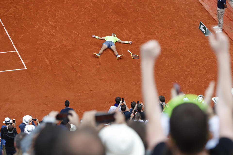 Spain's Rafael Nadal lays on the clay as he defeats Austria's Dominic Thiem during the men's final match of the French Open tennis tournament at the Roland Garros stadium in Paris, Sunday, June 9, 2019. Nadal won 6-3, 5-7, 6-1, 6-1. (AP Photo/Pavel Golovkin)