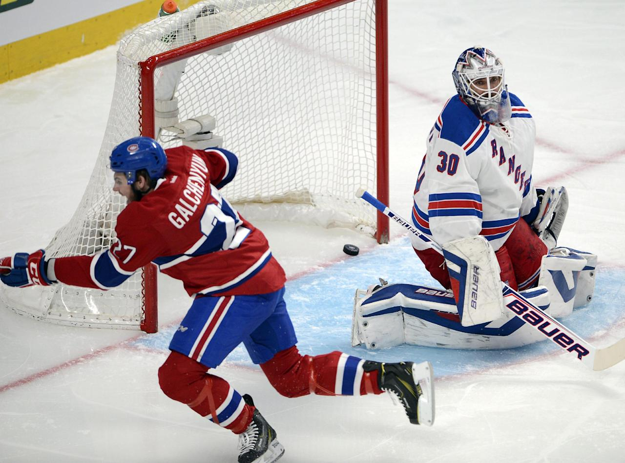 Montreal Canadiens' Alex Galchenyuk celebrates after scoring on New York Rangers goalie Henrik Lundqvist during the first period of Game 5 of the NHL hockey Stanley Cup playoffs Eastern Conference finals, Tuesday, May 27, 2014, in Montreal. (AP Photo/The Canadian Press, Ryan Remiorz)