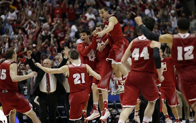 Wisconsin players react as time runs out in overtime in a regional final NCAA college basketball tournament game, Saturday, March 29, 2014, in Anaheim, Calif. Wisconsin won 64-63 in overtime. (AP Photo/Jae C. Hong)
