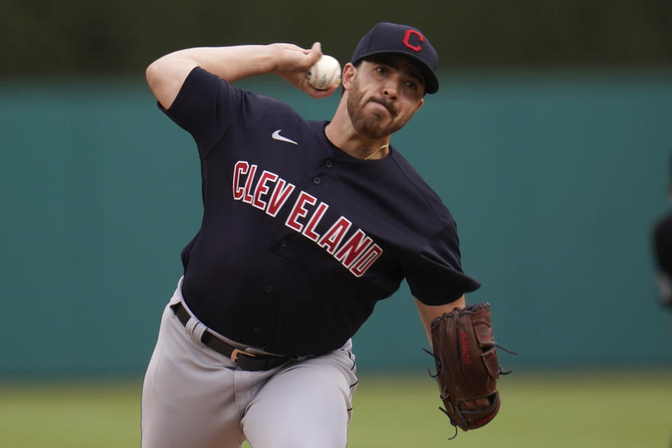 Cleveland Indians pitcher Aaron Civale throws against the Detroit Tigers in the first inning of a baseball game in Detroit, Tuesday, May 25, 2021. (AP Photo/Paul Sancya)