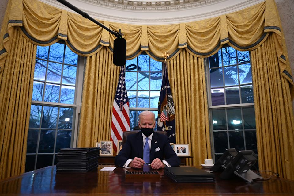 U.S. President Joe Biden holds a pen as he prepares to sign a series of orders in the Oval Office of the White House in Washington, D.C., after being sworn in at the US Capitol on Jan. 20, 2021. (Photo: JIM WATSON via Getty Images)