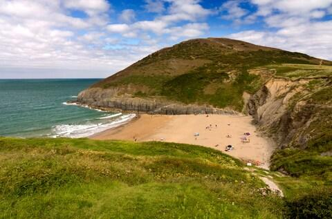 Mwnt, a generous thumbprint of golden sand flanked by rounded cliffs - Credit: getty