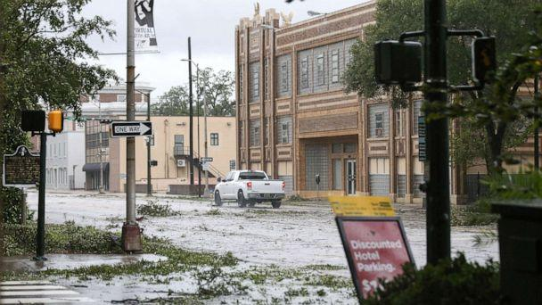 PHOTO:A car drives down Government Street during Hurricane Sally in Mobile, Ala., Sept. 16, 2020. (Jonathan Bachman/Reuters)