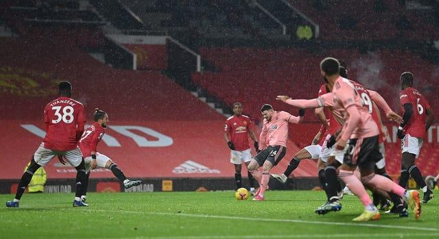 Oliver Burke fired Sheffield United to victory at Old Trafford