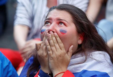 Soccer Football - World Cup - Group A - Uruguay vs Russia - St. Petersburg, Russia - June 25, 2018. A Russia's fan reacts as she watches the broadcast at the Saint Petersburg Fan Fest. REUTERS/Anton Vaganov
